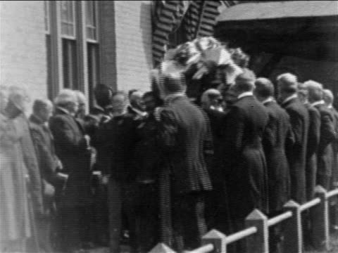 B/W 1901 men carrying casket of President McKinley at funeral / newsreel