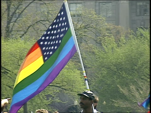 vídeos de stock e filmes b-roll de men carrying gay pride american flags in washington dc - 1993