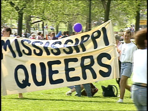 men carrying 'mississippi queers' banner through park in washington dc - 1993 stock-videos und b-roll-filmmaterial