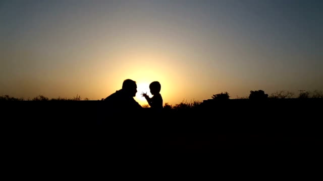 men & child playing silhouette outdoor - son stock videos & royalty-free footage