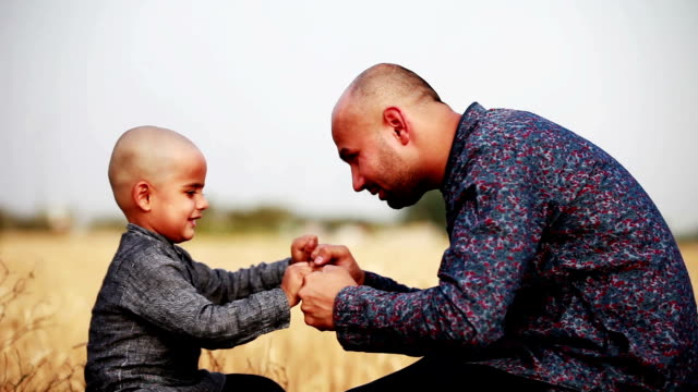 men & child playing together outdoor in nature - hugging self stock videos & royalty-free footage