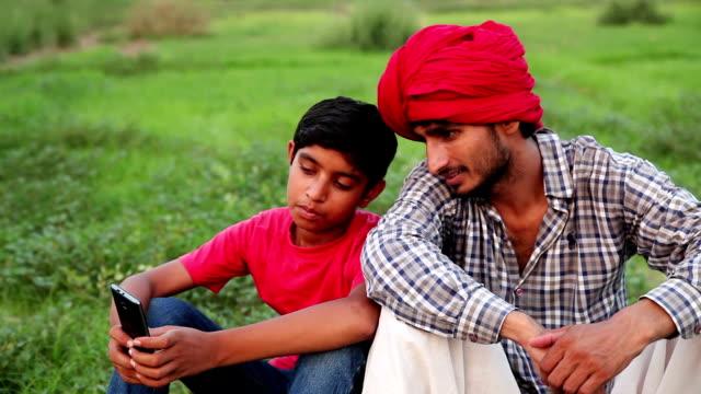 Men & child using mobile phone