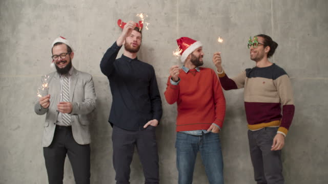men christmas fun infront of concrete wall - santa hat stock videos & royalty-free footage