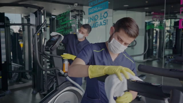 men cleaned treadmills carried out disinfection protocols for the covid-19 pandemic - clean stock videos & royalty-free footage