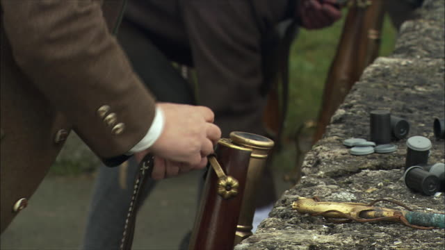 cu tu men cleaning and loading guns, christmas gun salute at hohensalzburg fortress / salzburg, austria - gunpowder explosive material stock videos & royalty-free footage