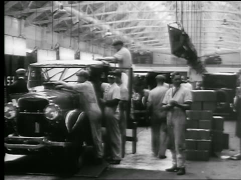 b/w 1927 men cleaning car at end of assembly line in factory / new york state - 1920 stock-videos und b-roll-filmmaterial