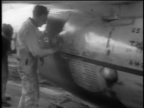 "men cleaning ""winnie mae"" prop plane on airfield / cleveland, oh / newsreel - 1935 stock videos & royalty-free footage"