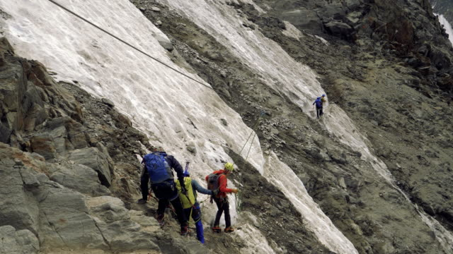 men climb to mont blanc mountain - clambering stock videos & royalty-free footage