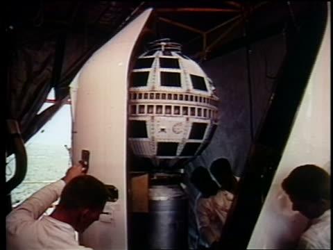 1962 men closing casing on telstar / documentary - telstar stock-videos und b-roll-filmmaterial