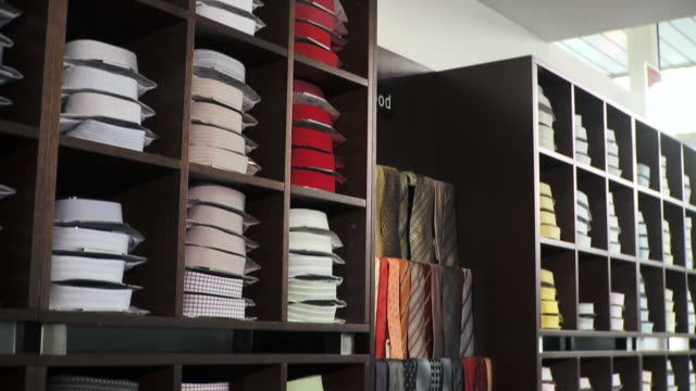 hd: men clothing store - folded stock videos and b-roll footage