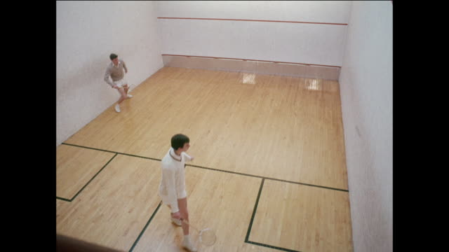 MONTAGE Men compete in racquetball court / UK