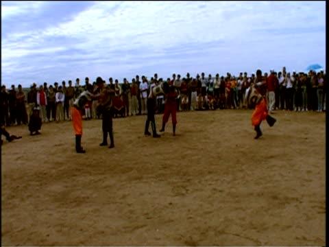 men compete in traditional wrestling sport büke inner mongolia - wrestling stock videos and b-roll footage