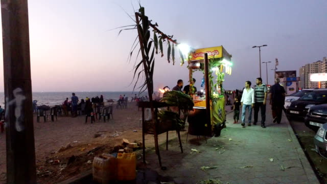 men cook corn on a food stall at the main beach on july 21 2017 in gaza city gaza for the past ten years gaza residents have lived with constant... - gaza city stock videos & royalty-free footage