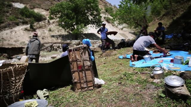 men cooking at camp at himalaya / durma banke district nepal - nepal stock-videos und b-roll-filmmaterial