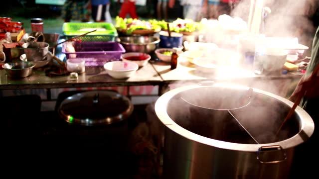 Men cooking noodle