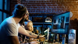 Men creating cartoon on computer