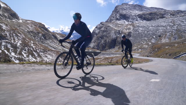 men cycling on bicycles, friends tracking winter riding on road bikes in france. - 30 34 years stock videos & royalty-free footage