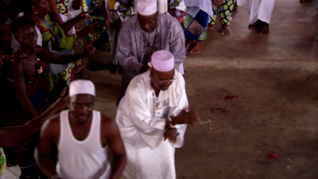 men dance in a voodoo ceremony. available in hd. - benin stock videos and b-roll footage