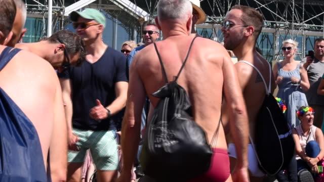 Men dancing in the street to celebrate the Brighton Gay Pride Parade 2017
