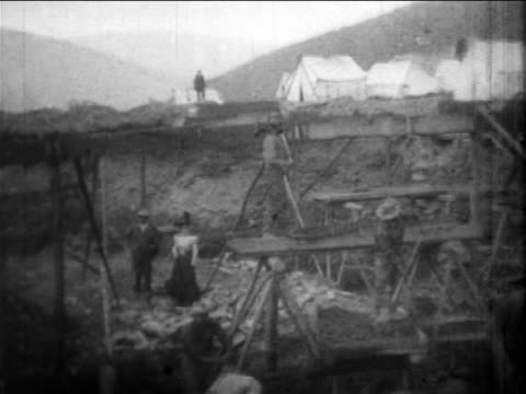 B/W 1898 men digging gold sluice / newsreel