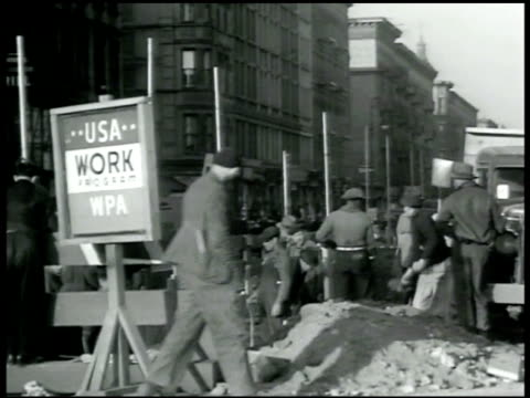 stockvideo's en b-roll-footage met men digging in street w/ us works program sign fg. sign; pwa federal emergency administration of public works. key west bridge construction,... - 1933