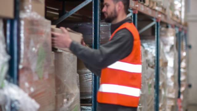Men distributing boxes in warehouse