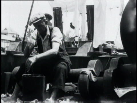 men doing laundry in a bucket in a hooverville shantytown / usa - 1932 stock videos & royalty-free footage