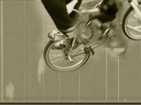 men doing stunts on bmx bicycles - viraggio monocromo video stock e b–roll