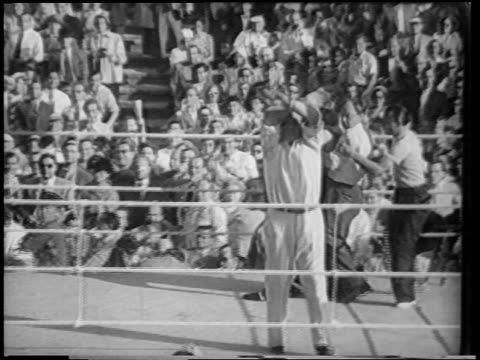 vídeos y material grabado en eventos de stock de b/w 1951 men dragging gerhard hecht to corner of boxing ring as referee gestures to audience - 1951