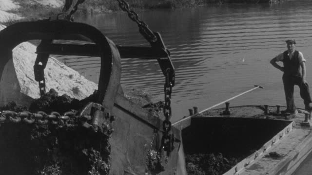 montage men dredging river beds to reinforce the banks / united kingdom - 1948年点の映像素材/bロール