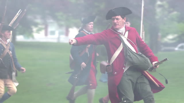 men dressed as colonial war soldiers reenact a revolutionary battle. - revolution stock videos & royalty-free footage
