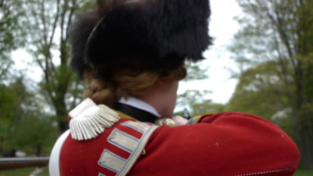 men dressed as revolutionary war soldiers fire muskets - revolution stock videos & royalty-free footage