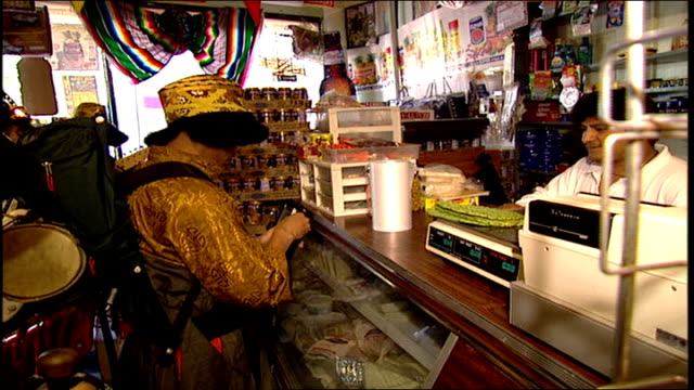 men dressed as sherpas buying items in bodega in nyc - anno 1999 video stock e b–roll