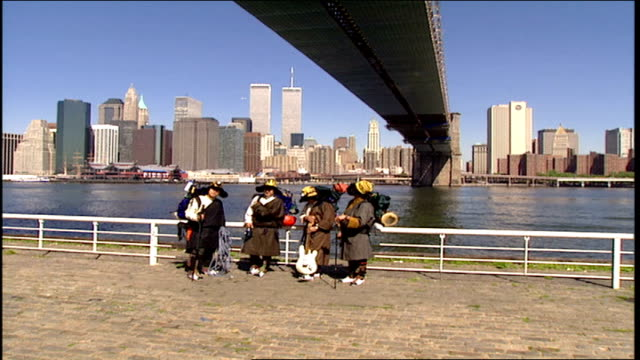 men dressed as sherpas looking at wtc across east river under brooklyn bridge - asian tribal culture stock videos and b-roll footage