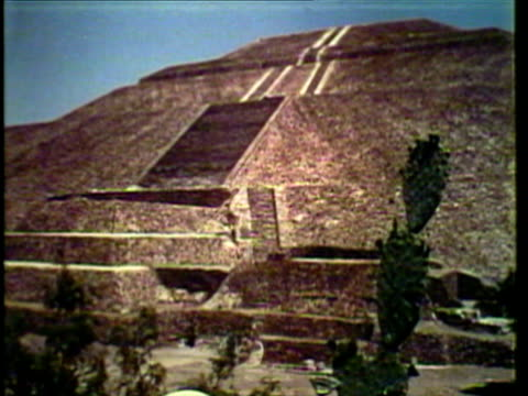 1953 ws men dressed in aztec garb climbing pyramid steps / mexico city, mexico / audio - aztec civilization stock videos and b-roll footage