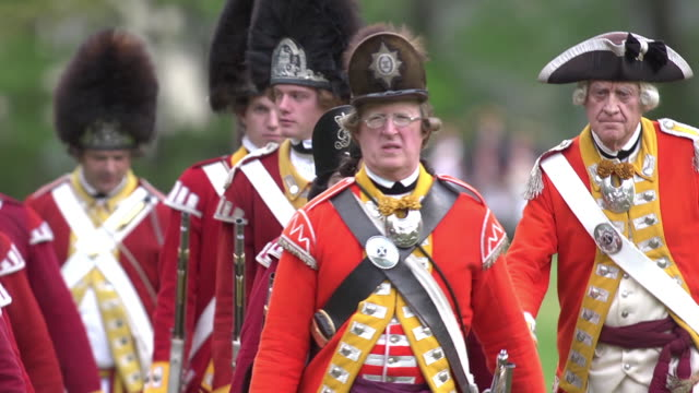 men dressed in detailed revolutionary war red coat uniforms march in rows. - coat stock videos & royalty-free footage