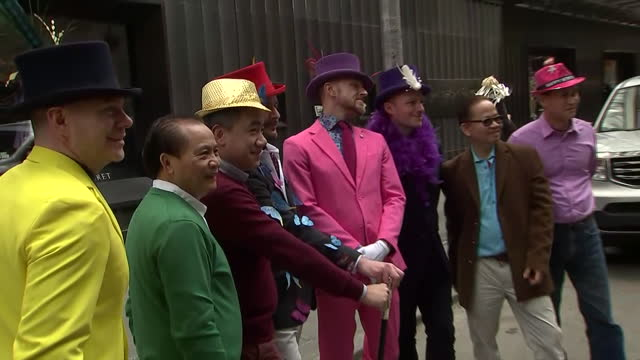 men dressed up with colorful suits and festive hats for the easter parade - bonnet stock videos & royalty-free footage