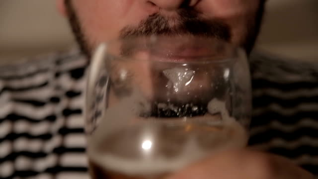Men drinking beer,close up