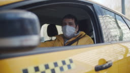 Men driving a taxi car in protective mask and rubber gloves
