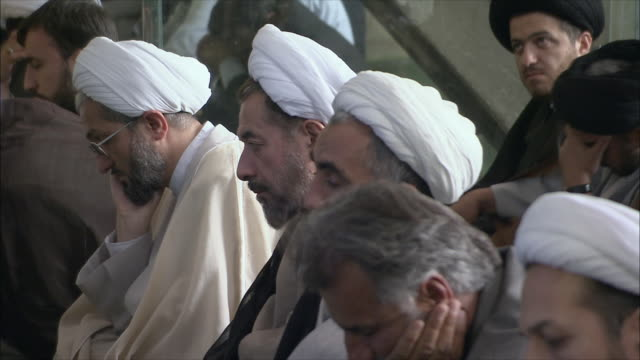cu td selective focus men during friday prayers in imam mosque, esfahan, iran - turban stock videos & royalty-free footage