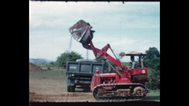 men earth mover working on a construction site in the british colony of british north borneo from the home movie collection of jack dennis boles who... - colonial stock-videos und b-roll-filmmaterial