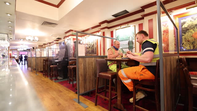 men eating at reopened chinese restaurant with tables separated with dividing screens in chinatown, london, uk, on monday, may 17, 2021. - new normal concept stock videos & royalty-free footage