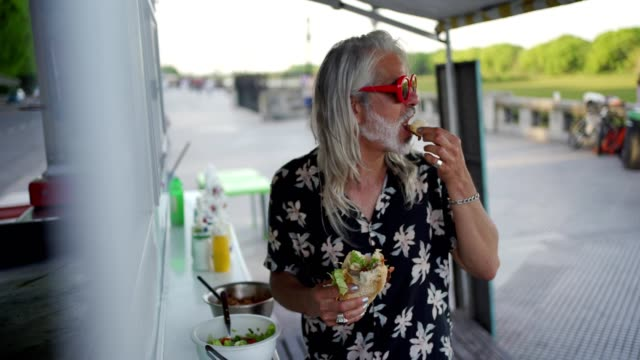 men eating food from food truck - fashionable stock videos & royalty-free footage
