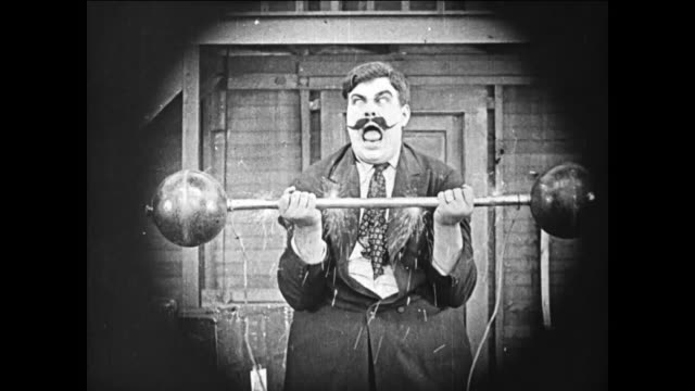 1919 Men (Buster Keaton & Fatty Arbuckle) electrocute boastful strongman (Charles A. Post) as he lifts barbells, knocking him unconscious