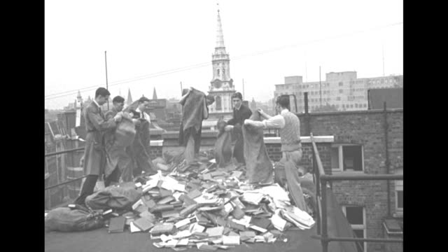 "men empty bags full of copies of adolf hitler's book ""mein kampf"" onto london roof at the start of world war ii / pile of books / books in pile / man... - book cover stock videos & royalty-free footage"