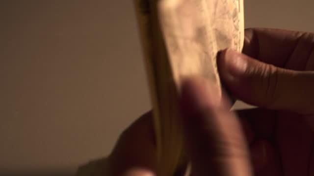 men enjoying cash money in hands. men counting yen banknotes. - plusphoto stock videos & royalty-free footage