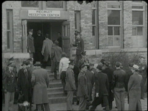 men enter a recruitment office and fill out forms. - military recruit stock videos & royalty-free footage