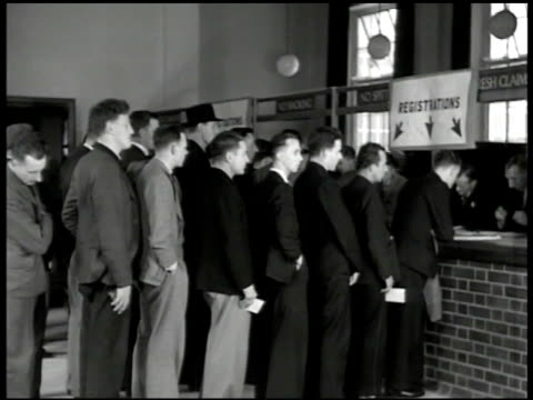 men entering recruitment building int men on line 'registration' vs men conversing signing up at registration booth ext ms english soldiers in gear... - military recruit stock videos & royalty-free footage