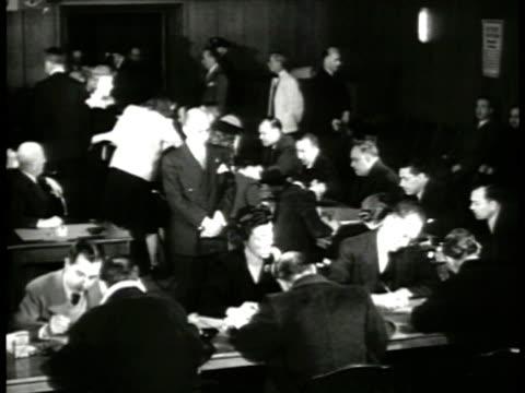 vídeos y material grabado en eventos de stock de men entering room sign 'register here...' int men registering at tables. middle-aged man signing papers. young & older men walking in line.... - military recruit
