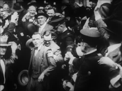 vidéos et rushes de b/w 1928 men escorting al smith thru crowd during presidential campaign / newsreel - 1928